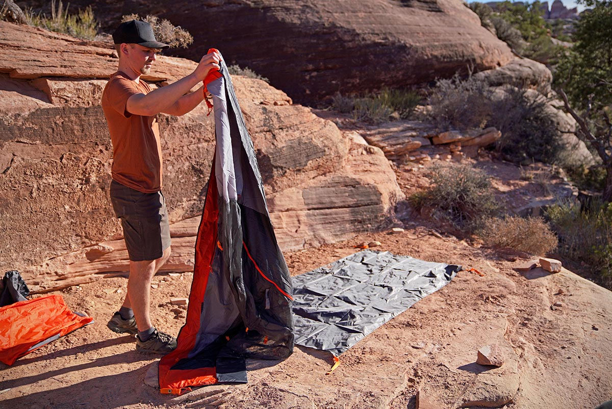 Setting up tent with footprint