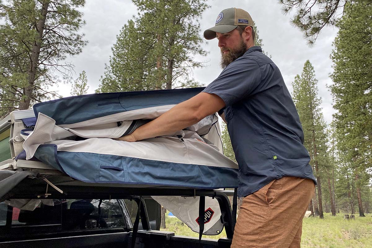 Stuffing away Tepui Low Pro rooftop tent
