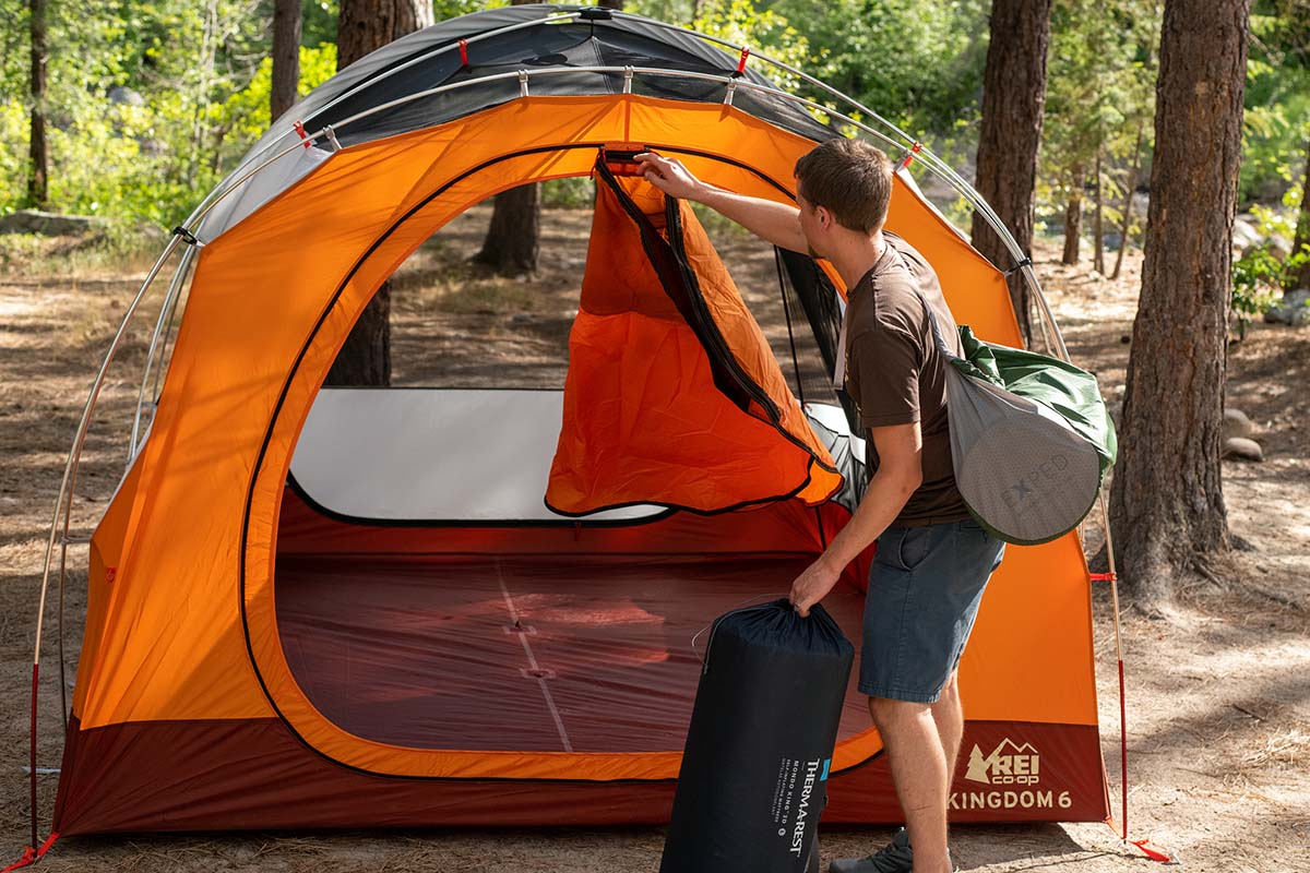 Camping tent (REI Kingdom 6 unzipping front door)