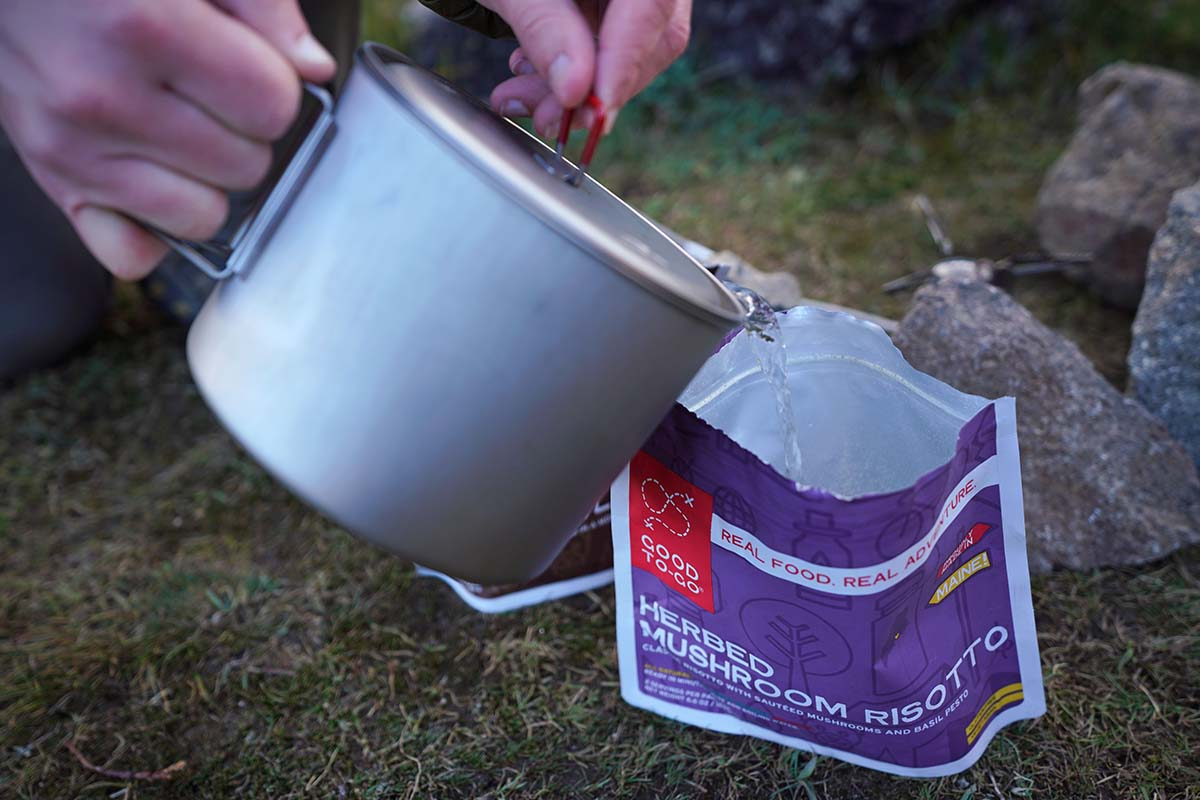 Backpacking food (pouring water into pouch)