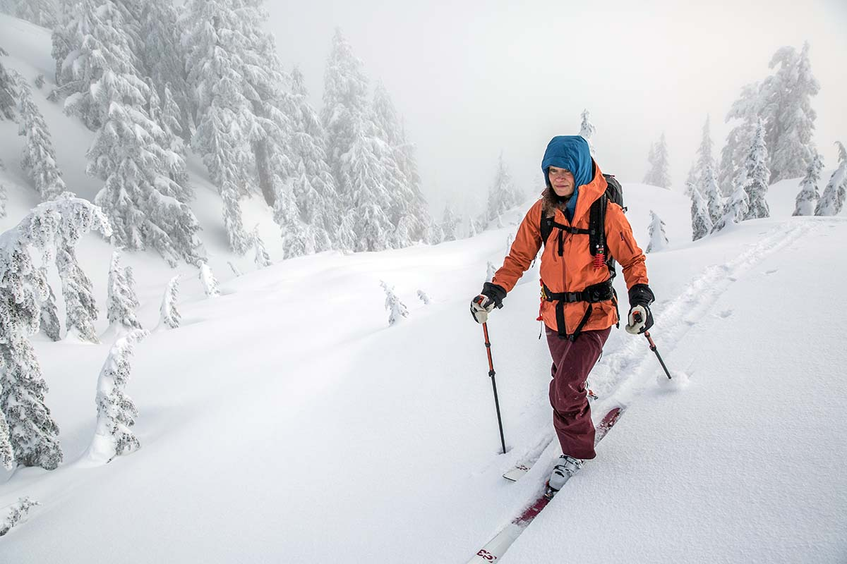Skinning wearing Arc'teryx Voltair avalanche airbag backpack