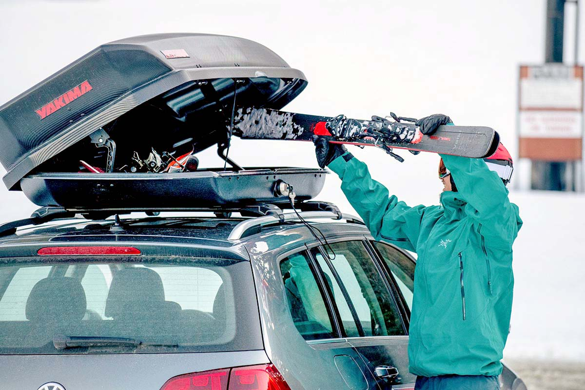 Loading skis into rooftop cargo box (Yakima SkyBox 16 Carbonite)