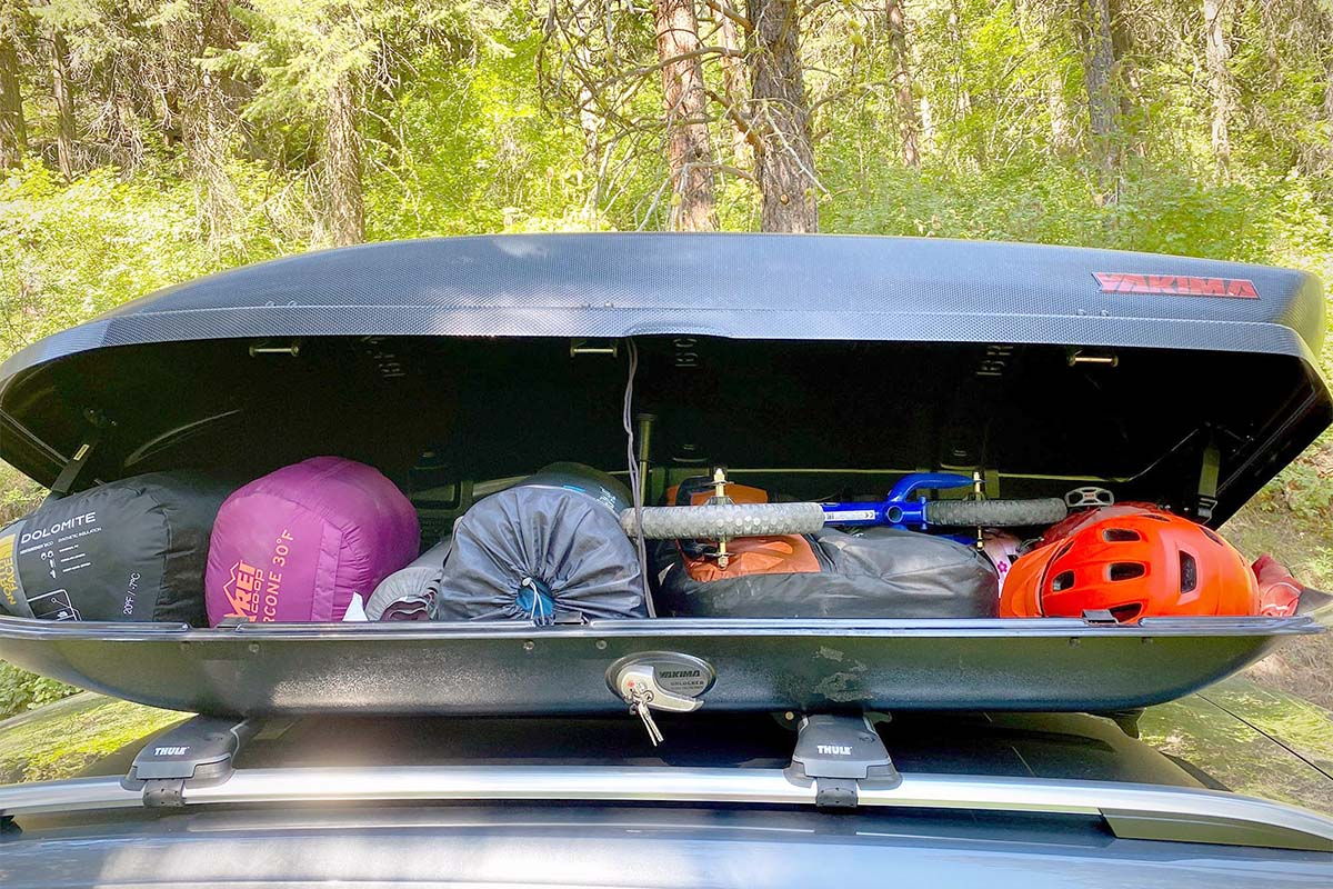 Rooftop cargo box loaded with gear (Yakima SkyBox 16 Carbonite)