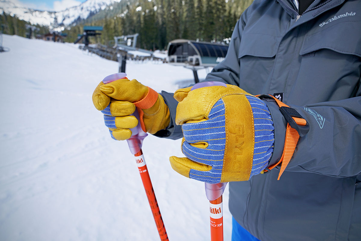 Ski gloves (Flylow gloves holding poles)