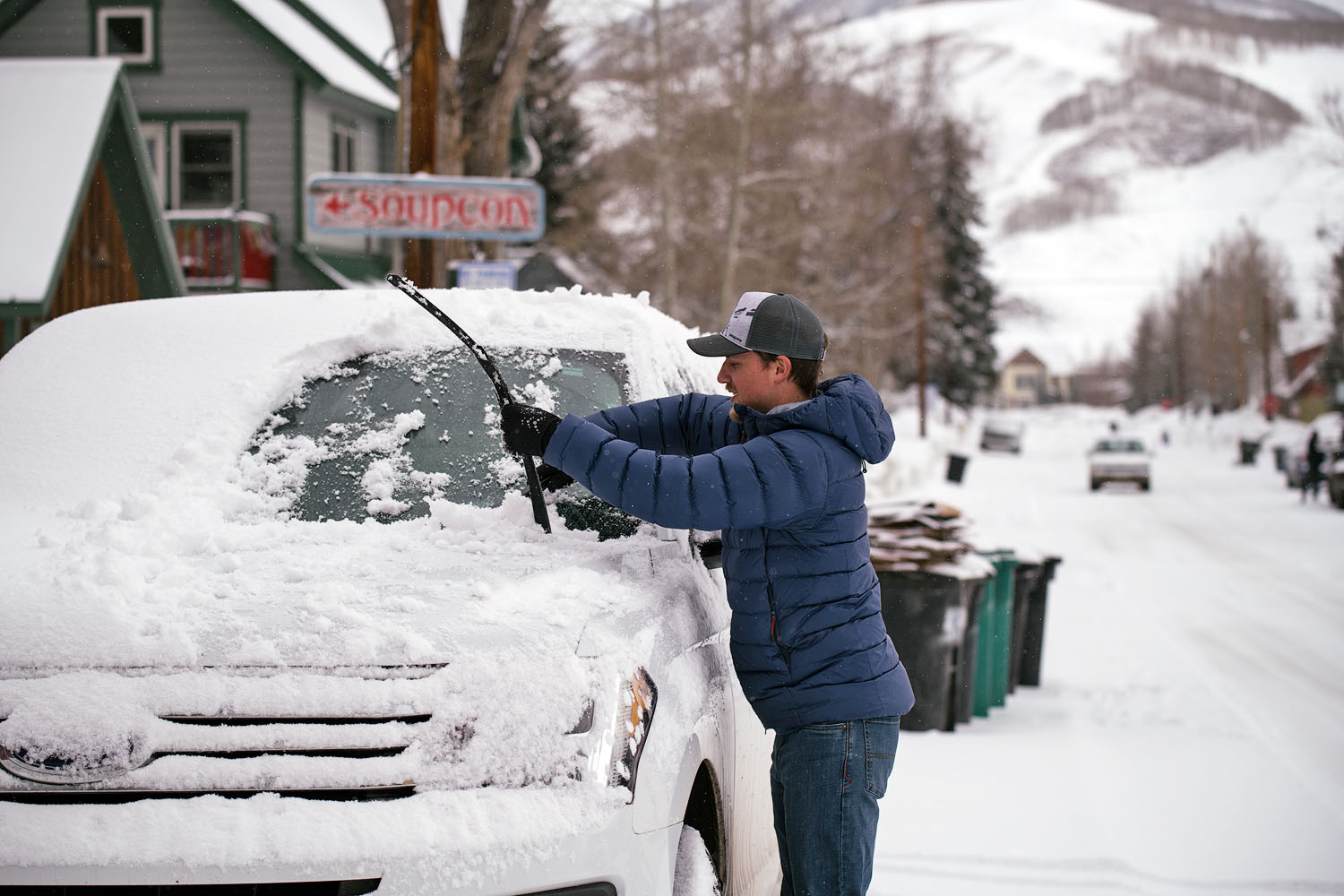 Winter jacket (Mountain Equipment Skyline cleaning off car)