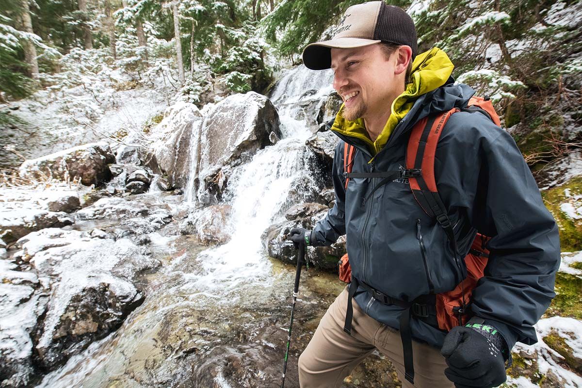 Smiling next to frozen waterfall (wearing Arc'teryx Beta AR hardshell jacket)