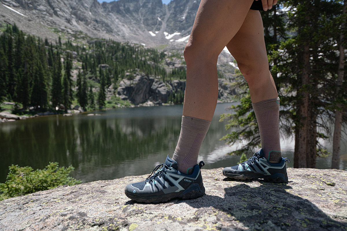 Oboz Arete hiking shoes (standing above alpine lake)