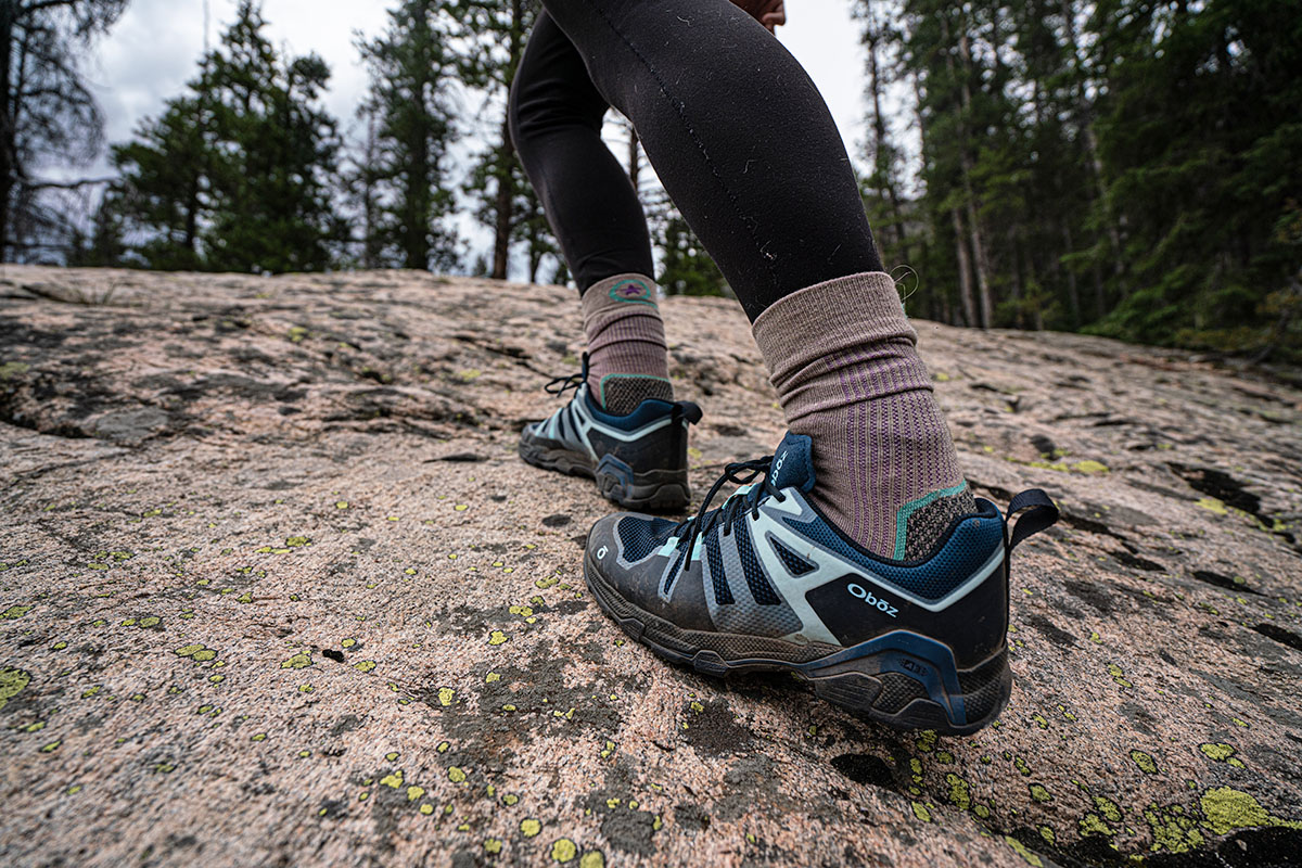 Oboz Arete hiking shoes (walking up slab)
