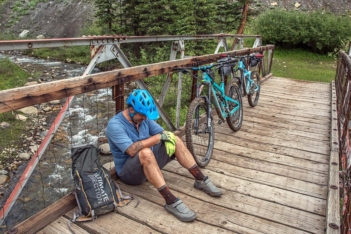 Resting on a bridge while bikepacking
