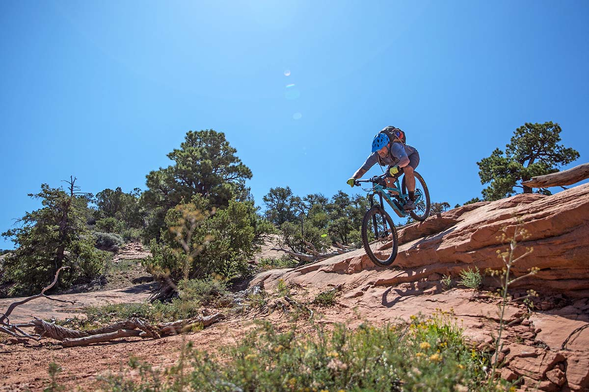 Biking downhill over red rock