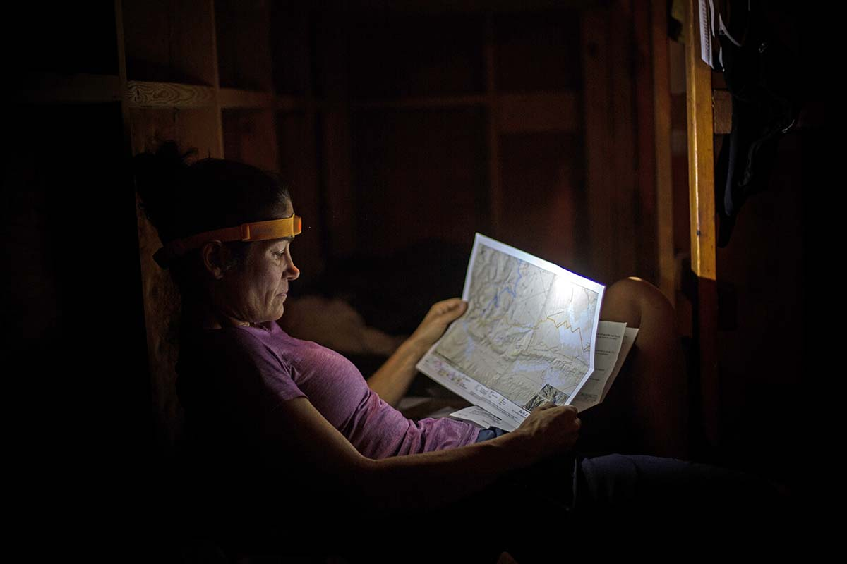 Reading a map with a headlamp while bikepacking