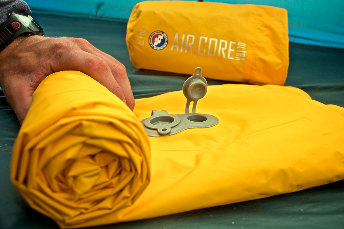 Sleeping pad (Big Agnes Air Core Ultra rolled up)