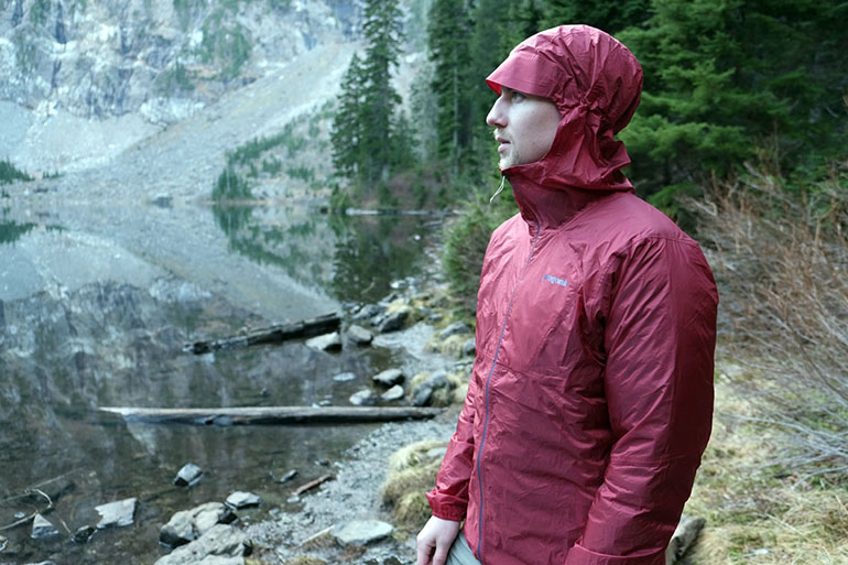 Rain shell over insulating jacket