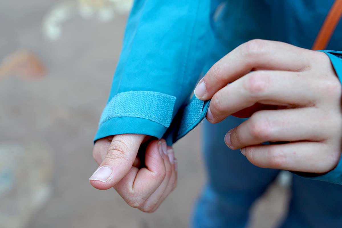 Adjusting cuff on Patagonia Calcite rain jacket