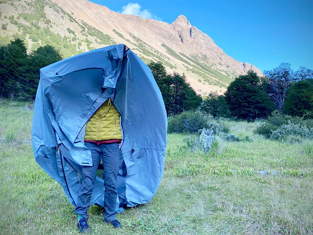 Backpacking tent (collapsed and holding up in front of face)