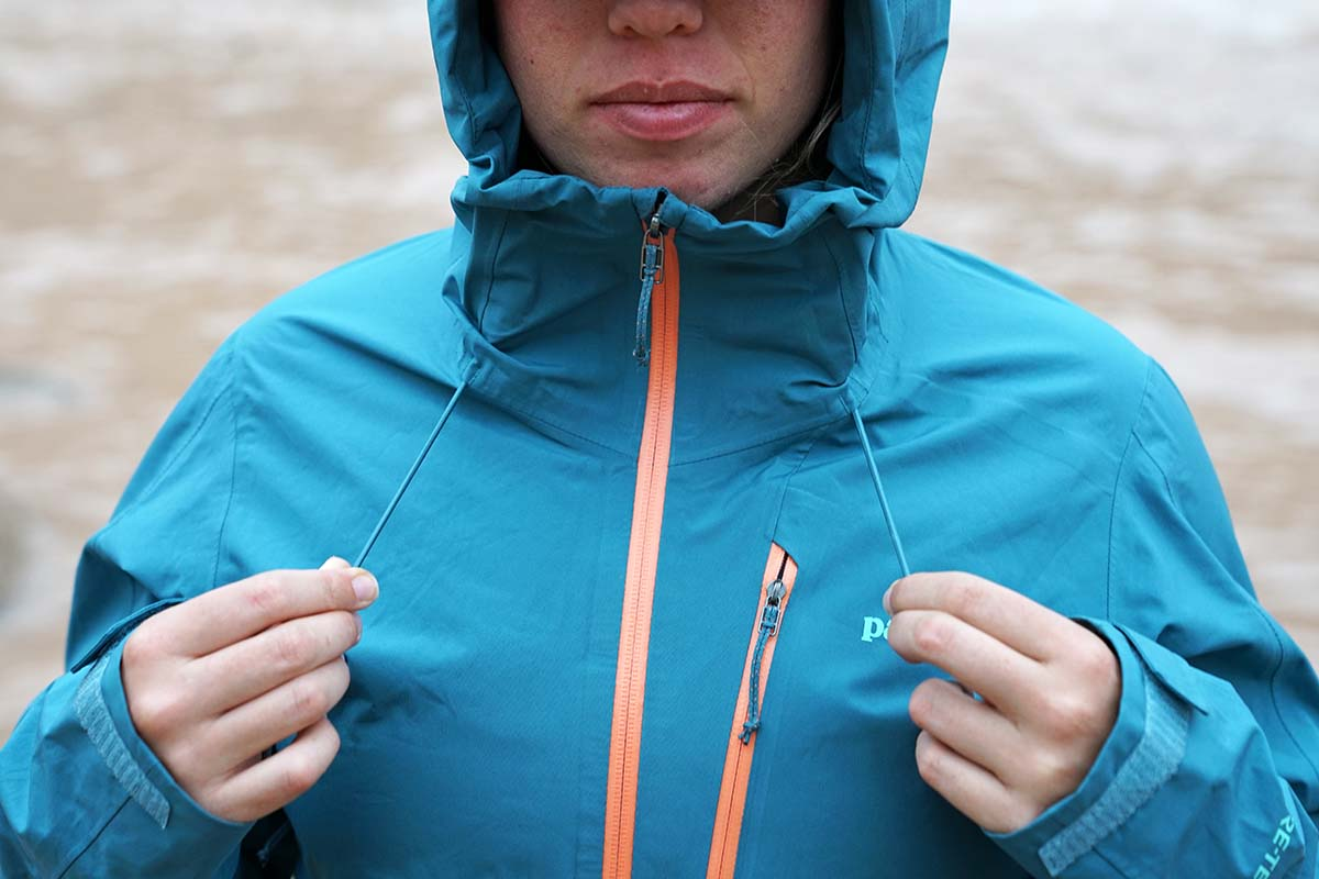 Cinching hood in Patagonia Calcite Rain Jacket