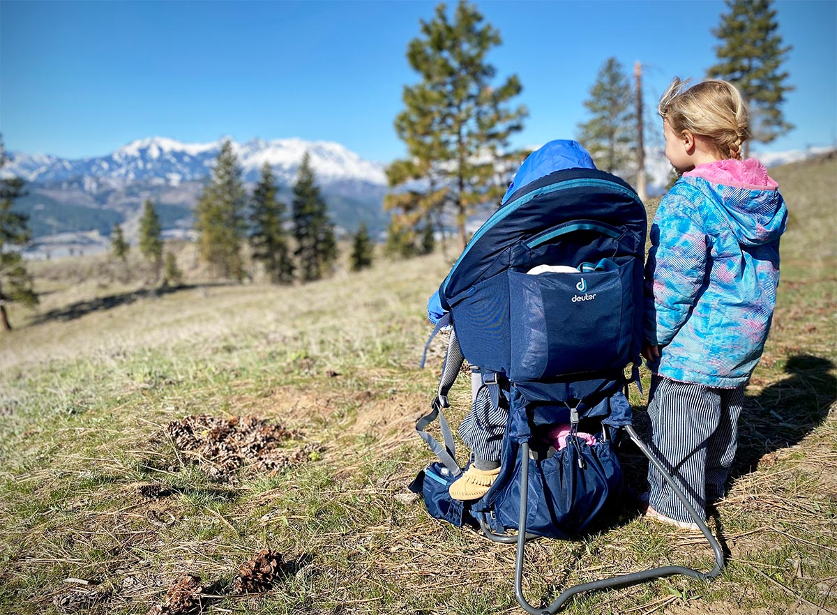 Deuter Kid Comfort baby carrier (foot stand deployed and mountain view)