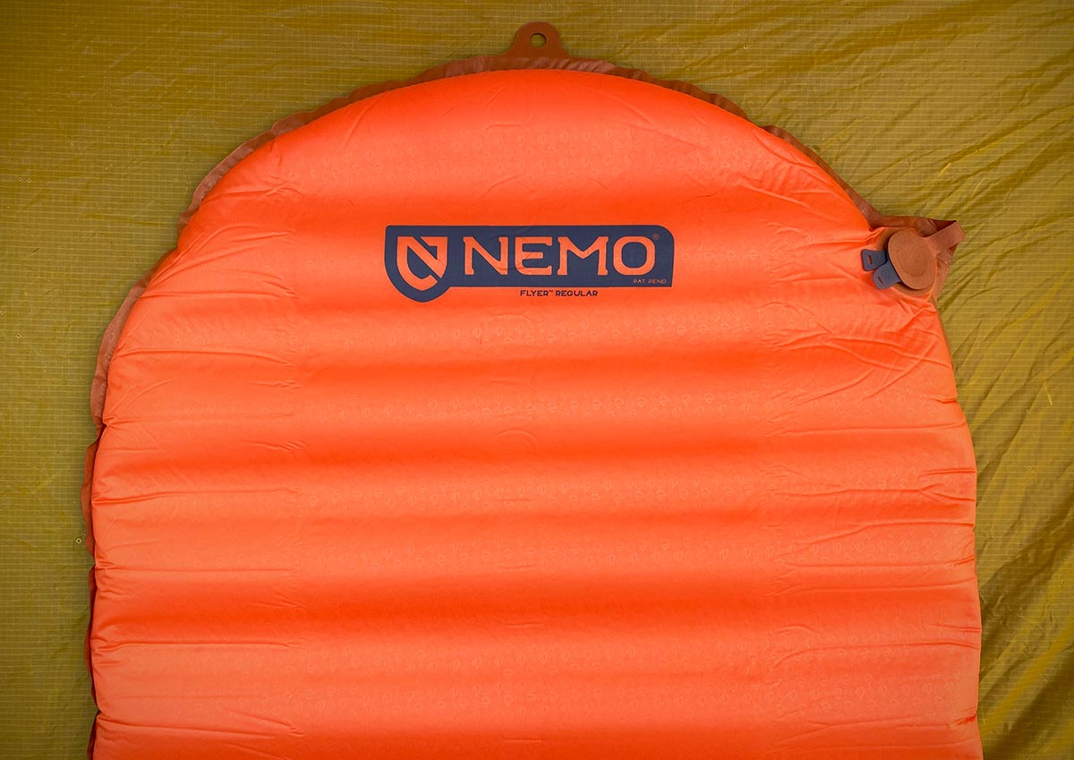 Backpacking sleeping pad (Nemo Flyer laying inside tent)