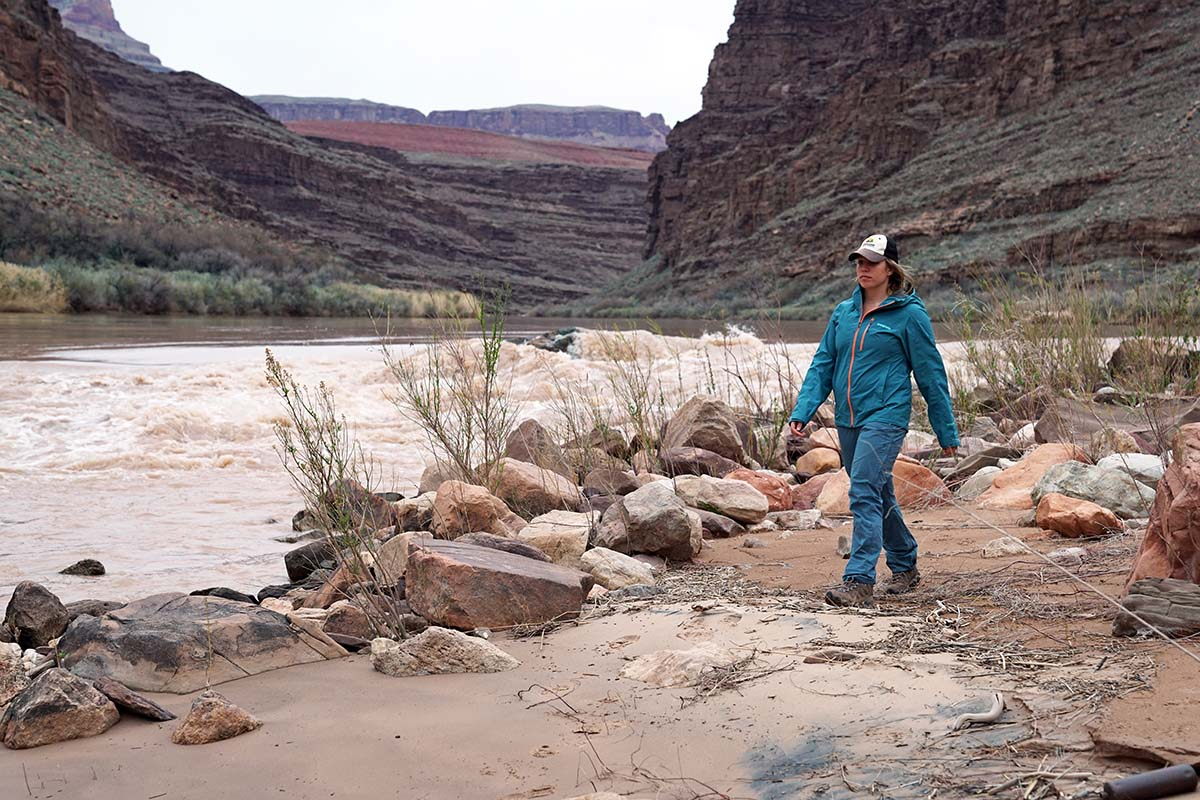 Walking beside Colorado River in Patagonia Calcite rain jacket