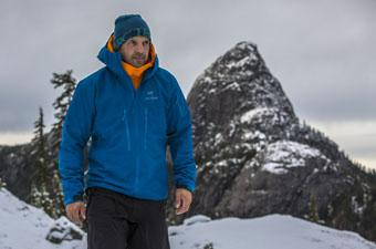 Arc'teryx Alpha SV hardshell jacket (mountain backdrop)