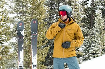 Arc'teryx Macai ski jacket (zipping up with skis)