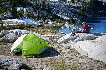 Backpacking checklist (tent set up by lake)