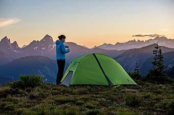 Backpacking tent (high on ridge overlooking mountains)
