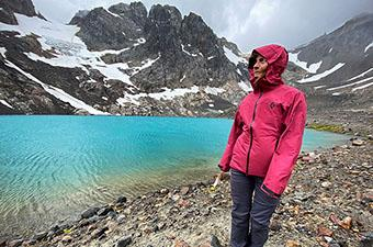 Black Diamond Liquid Point rain jacket (standing beside glacial lake)