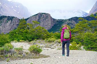 Day Hiking (woman hiking up Rio Electrico El Chalten)
