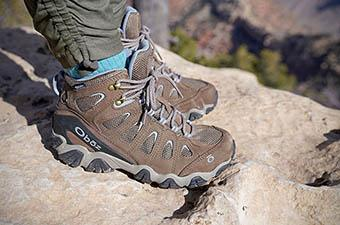 ​​​​Osprey Sawtooth hiking boot (standing on rock)