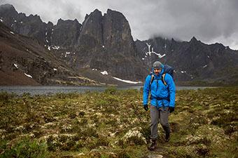 Patagonia Torrentshell 3L rain jacket (hiking by alpine lake)