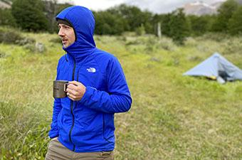 The North Face Ventrix Hoodie synthetic insulated jacket (holding coffee cup in camp)