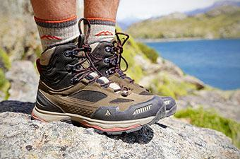 Vasque Breeze AT Mid hiking boots (standing on rock)