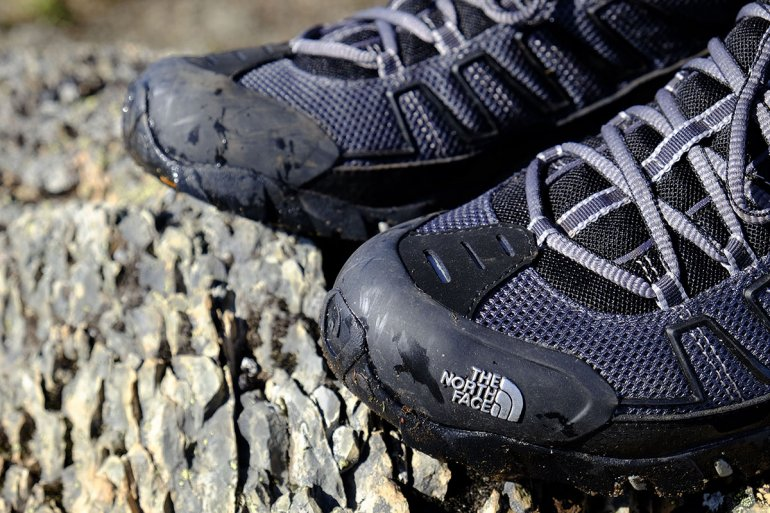 Trail-running shoe toe protection