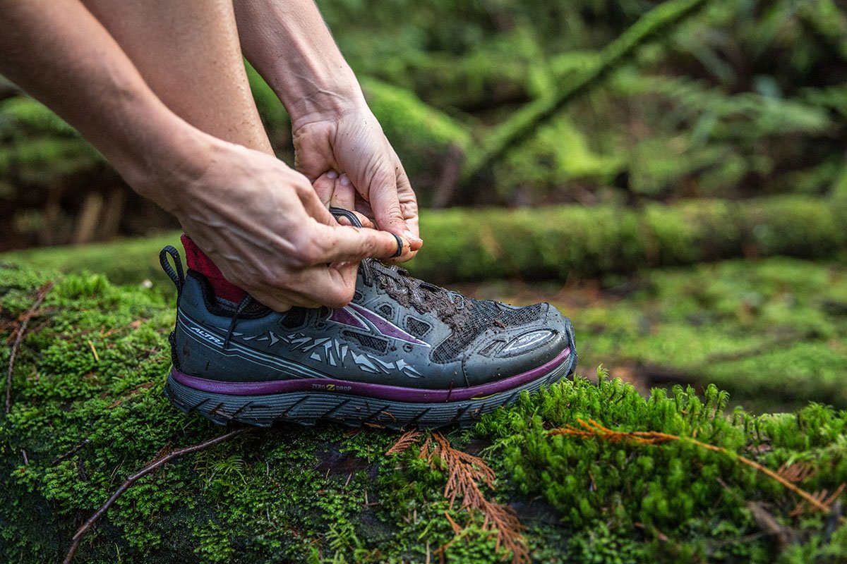 Altra Lone Peak 3.0 trail runner (lacing up)